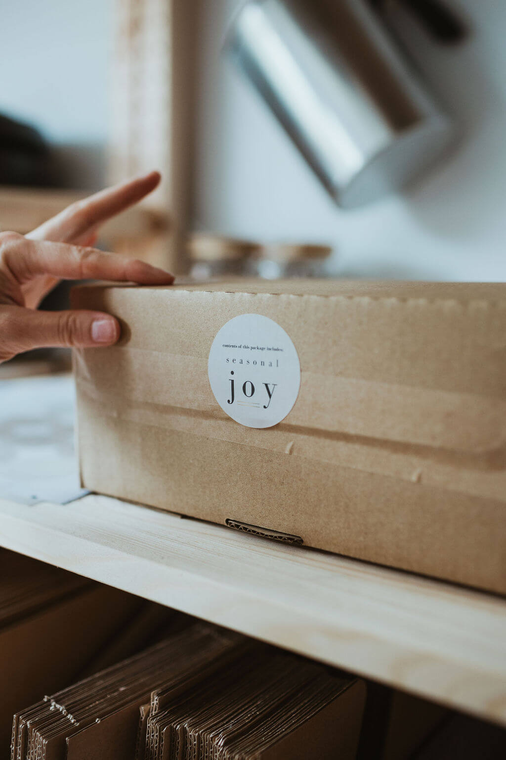 Packing the seasonal candle subscriptions at The Smallest Light